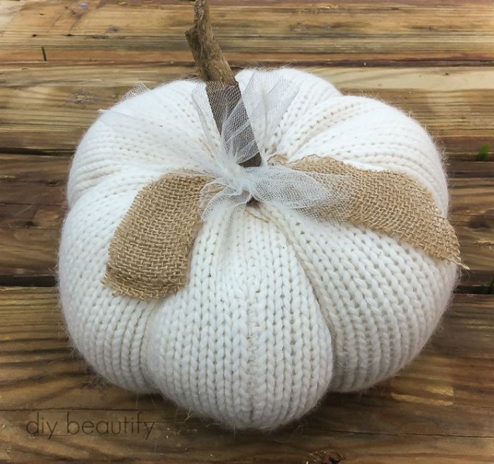 25+ Fabric Pumpkins | Each of these darling fabric pumpkin tutorials will have you using your fabric stash (or cutting up an old sweater)! And, they won't get funky smelling after Halloween! They'll last for years of fall decor.