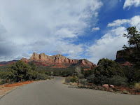Empty highway curving through the red mountains of Sedona, Arizona