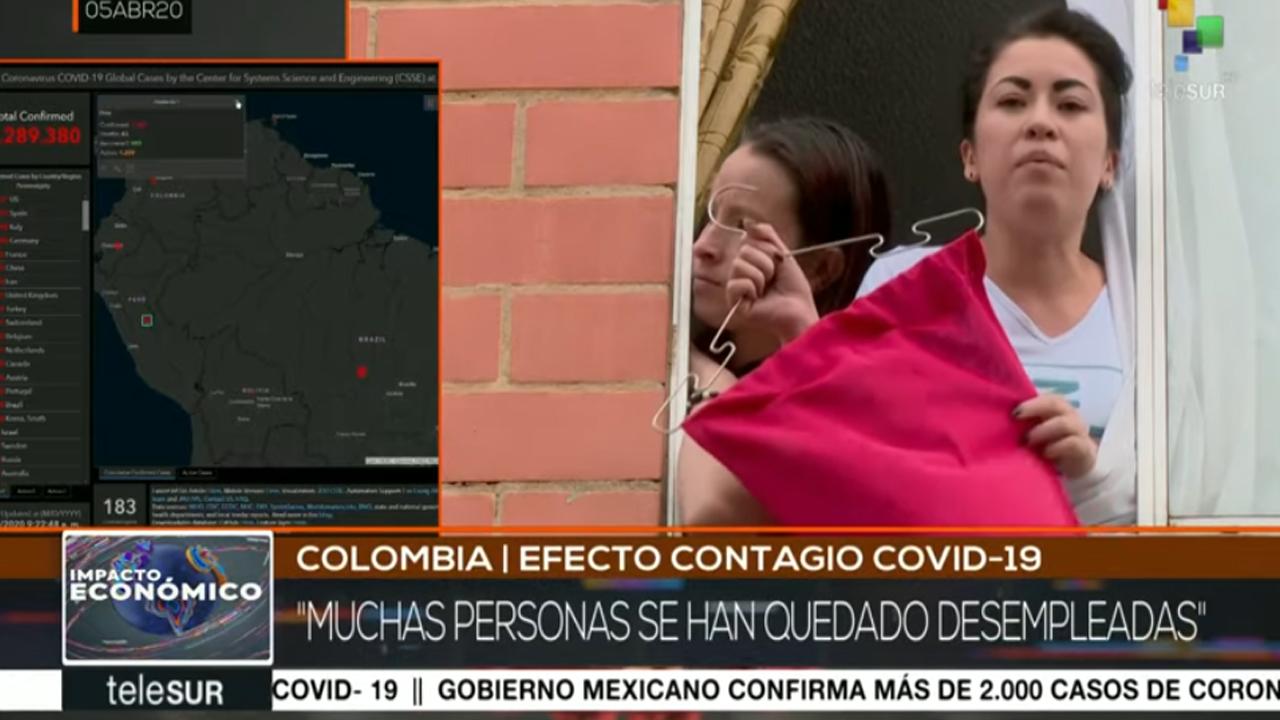 Colombia: con pañuelos rojos en sus casas piden ayuda al gobierno
