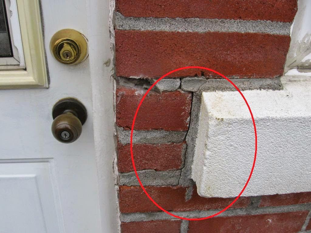 fissures mur en brique