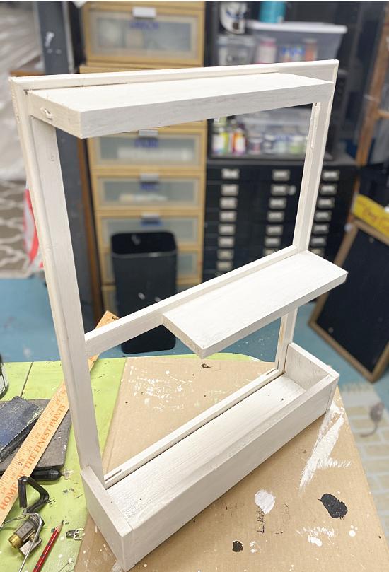 white shelves and planter box
