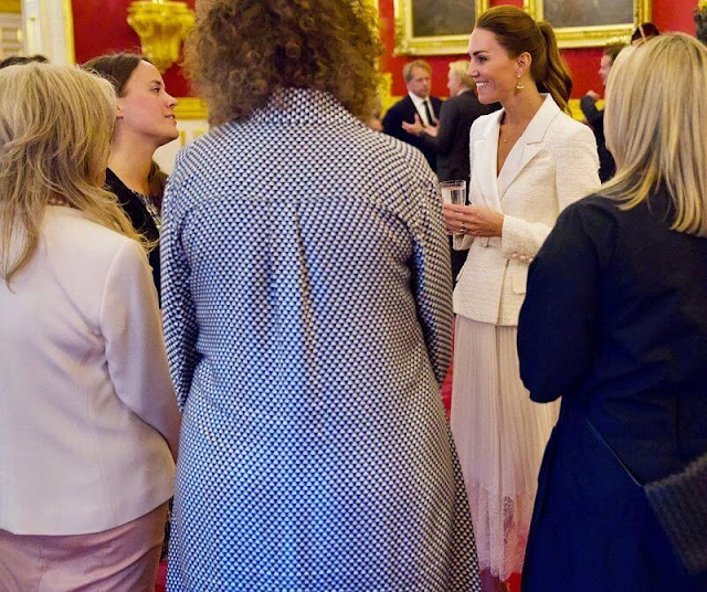 Kate Middleton wore a new cream tailored boucle and chiffon midi dress from Self Portrait