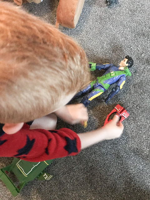 Overhead shot of little boy playing with the toys