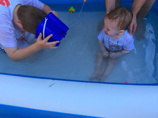 brothers playing the water