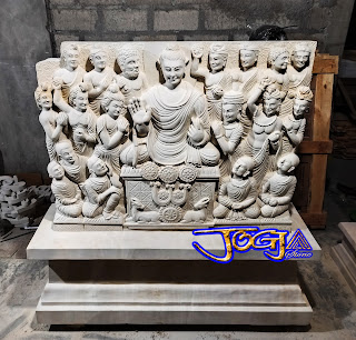 Kerajinan batu alam gambar Relief budha terbuat dari batu alam putih jogja (batu paras)