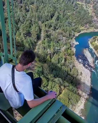 Woman survives after falling off California's tallest bridge while trying to take a selfie