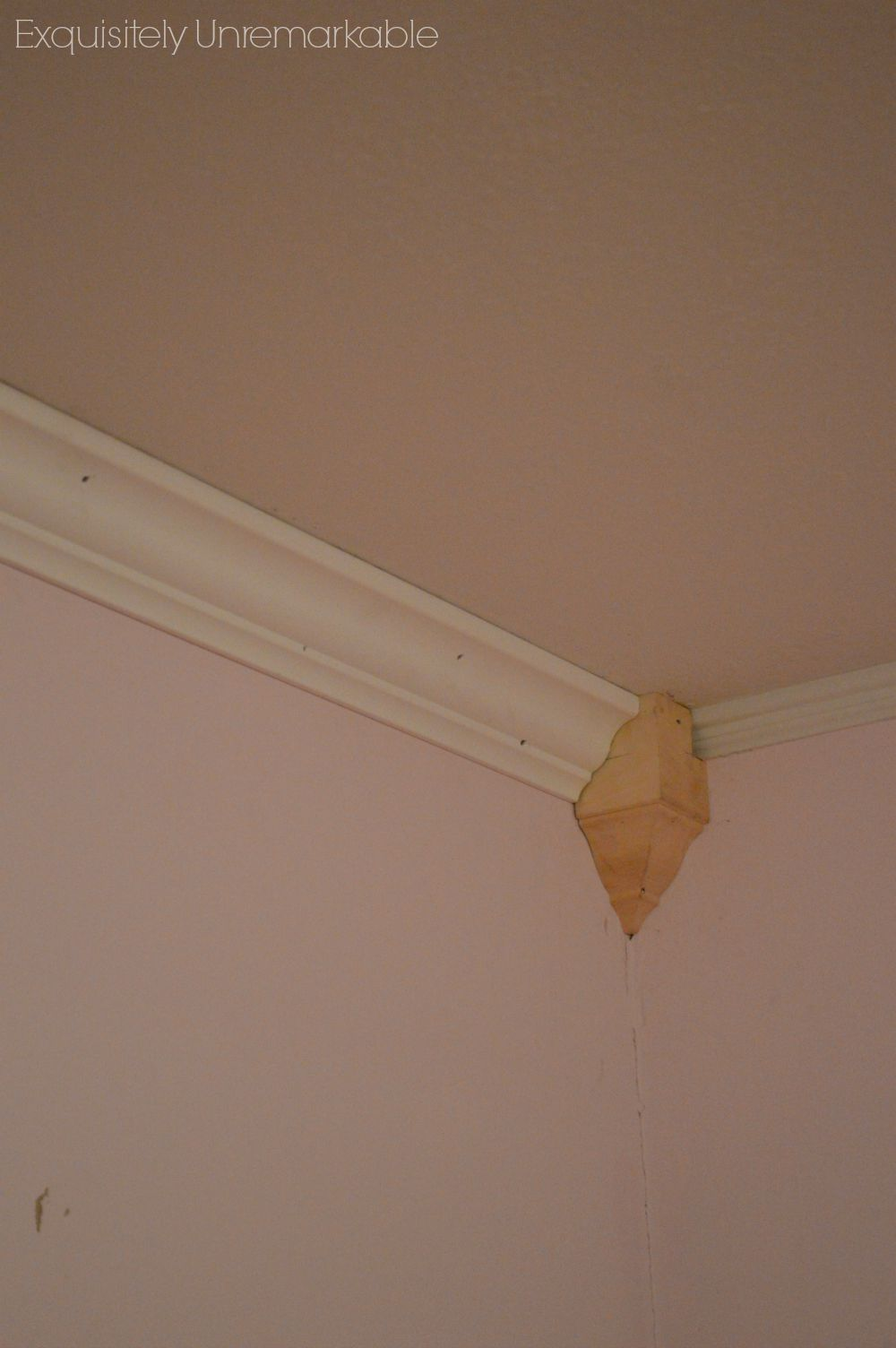 Adding an unfinished Corner Crown Molding block to a pink bedroom