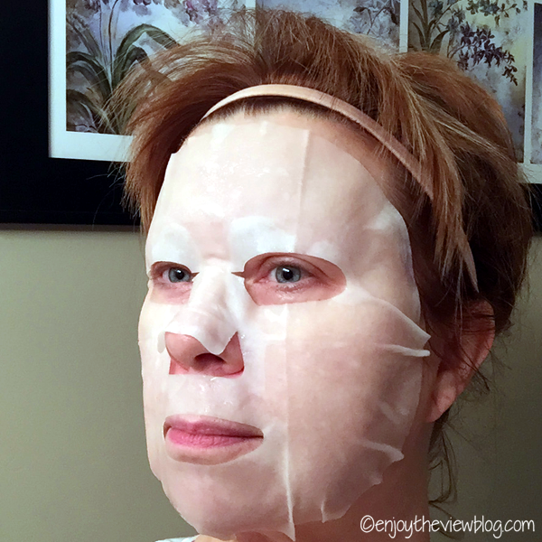 Woman wearing the Origins Flower Fusion™ Violet Nourishing mask