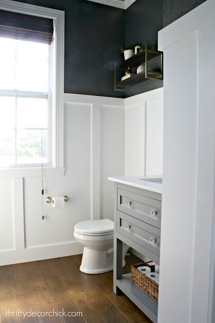 Tall white board and batten in bathroom