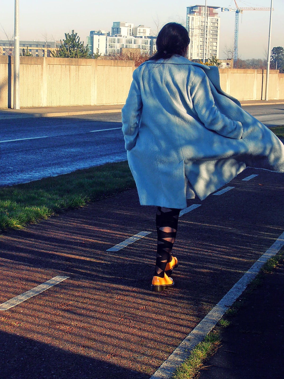 blue coat, yellow Dr Martens 1461