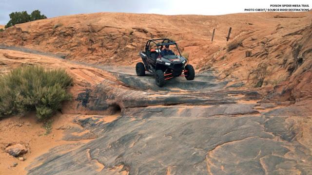 UTV driving down rock