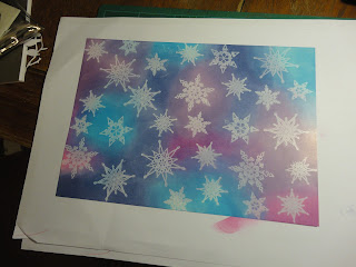 Background of  blue, purple and pink with white resist snowflakes