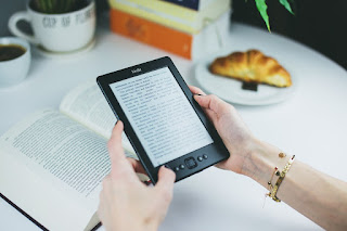 Image: Reading an ebook on a Kindle, by StockSnap on Pixabay