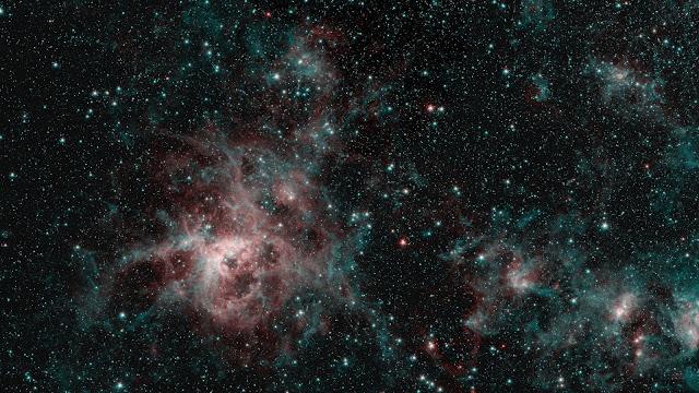 Tarantula Nebula spins web of mystery in Spitzer image