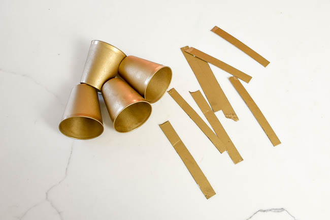 Spray painted Dollar Tree shot glasses and cardboard