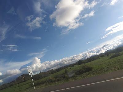 dutch angle landscape, blue sky and clouds