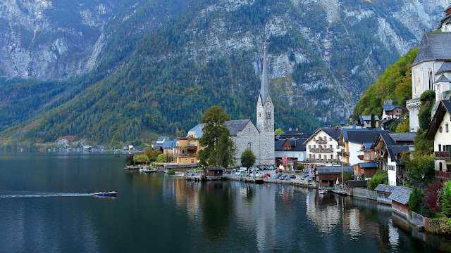 "Hallstatt town, Austria , Hallstatt Town in Guangdong, China , the Arendelle kingdom in Disney's ""Queen of Deborah"" ,  Dachstein Mountain Massif"