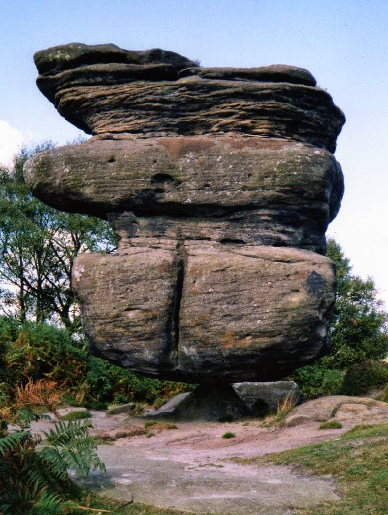Balance of Nature — 'Idol Rock' at Brimham Rocks in Nidderdale This colossus is balanced precariously and seemingly impossibley, on a small piece of rock, for reasons known only to Mother Nature herself. If we could ask her she might say 'it's because I can'.