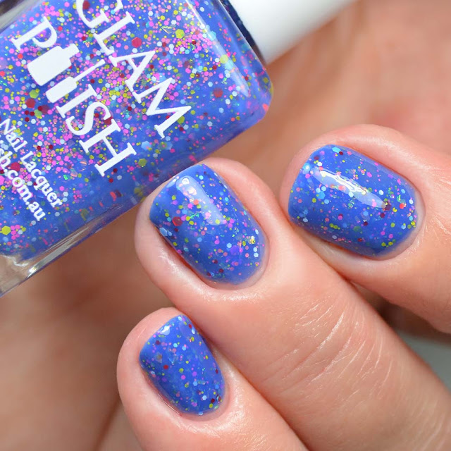 blue nail polish with glitter three finger swatch