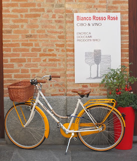Bicycle outside Alba, Italy wine shop.