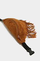 https://www.nastygal.com/want-you-should-swing-by-sometime-fringe-fanny-pack/AGG86108.html