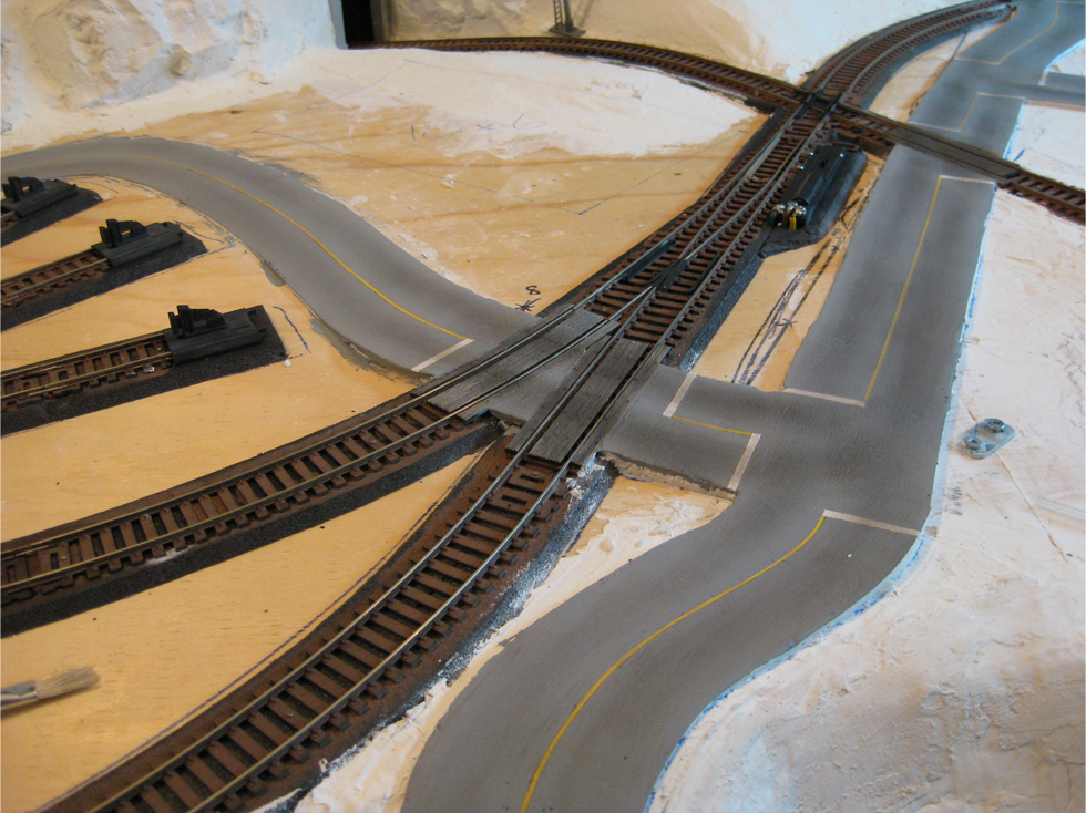 Completed model railroad plaster roads made from Smooth-It plaster and weathered with powdered pastels