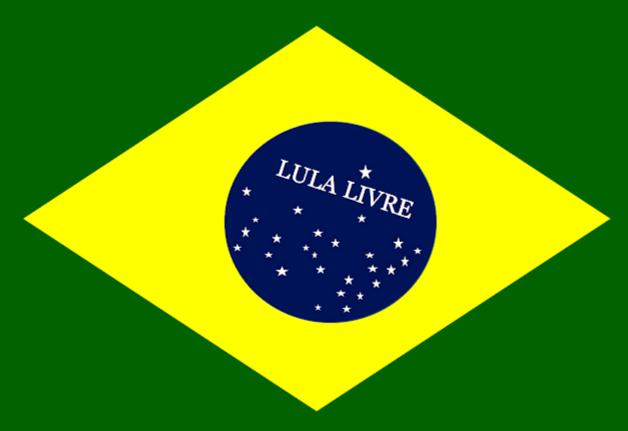 A imagem mostra a bandeira do Brasil e no Centro está escrito: Lula livre.