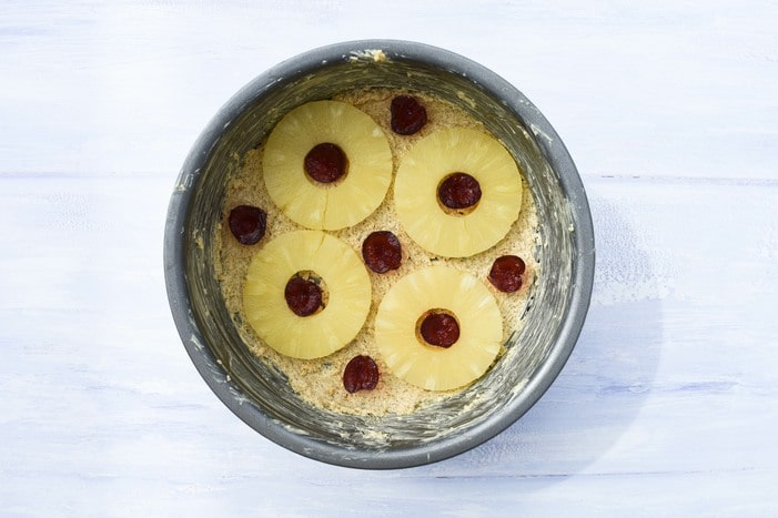 Pineapple & cherries in the bottom of a cake tin