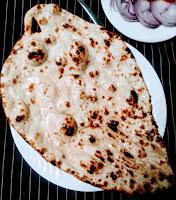 Serving tandoori butter naan