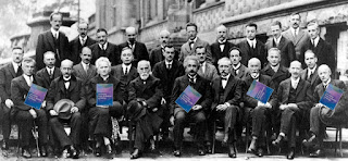 Participants at the Fifth Solvay Conference, holding copies of Intermediate Physics for Medicine and Biology.