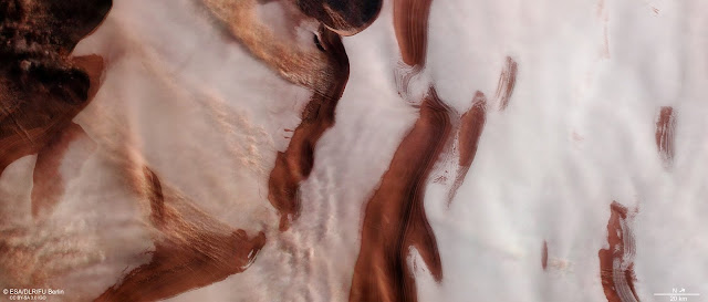 Rippling ice and storms at Mars' north pole