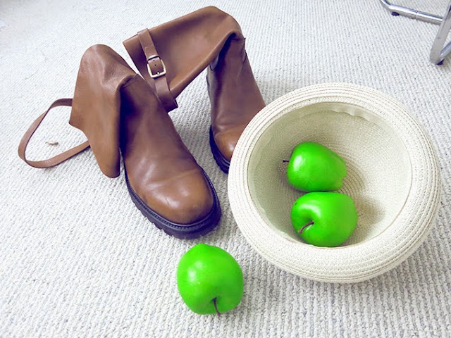 Sergio Rossi brown leather boots and green apples