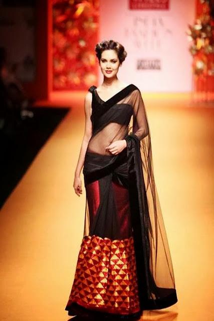 Bollywood Actress Esha Gupta in Simple Black with Red Net Lehenga Saree
