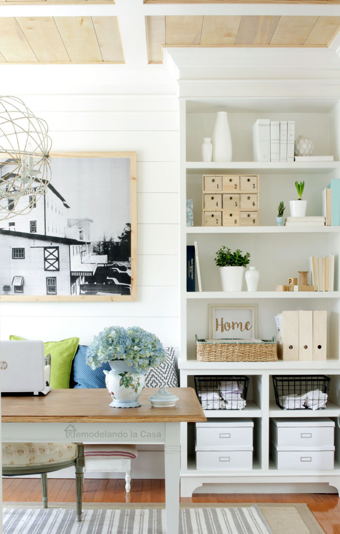 home office with built-ins and farmhouse table desk, rustic coffered ceiling