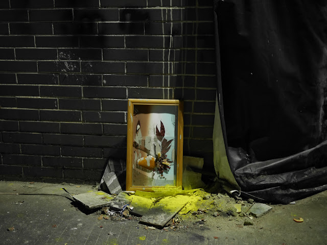 Piece of art in a broken frame in a Zhongshan alley