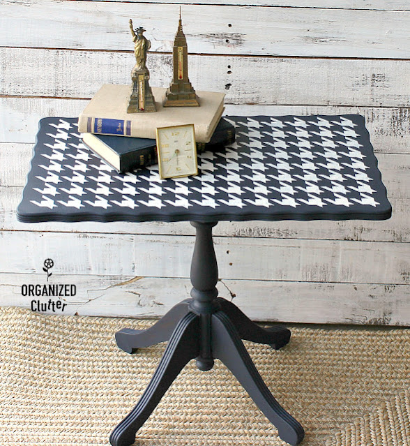 Photo of navy blue tea table with houndstooth stencil