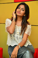 Eesha in a cute deep neck top and Skirt at at Big FM 008.JPG