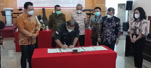 Elly Engelbert Lasut Tandatangani Kerjasama Pemkab Kepulauan Talaud dan Bank SulutGo.lelemuku.com.jpg