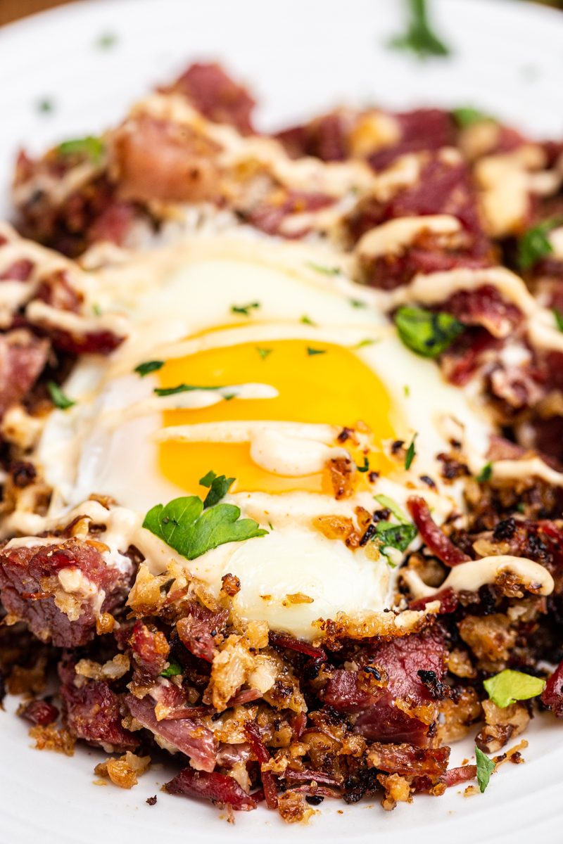 Closeup photo of a serving of Keto Corned Beef and Hash on a white plate.