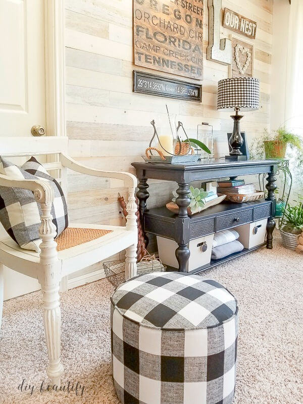 gallery wall and black and white buffalo plaid ottoman