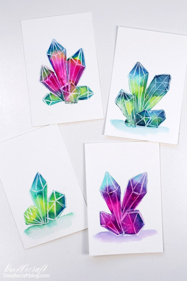 Painting a watercolor galaxy is such a fun technique, and painting them in little crystal clusters is absolutely dreamy! Geometric crystals are so fun to draw and much more simple than you might think! This fun craft is easy for all skill levels and great for beginners.