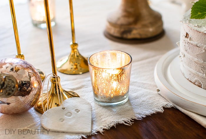 cozy winter decor with pink and gold