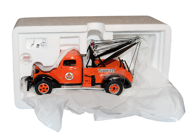 Supertest log on an orange tow truck - die cast metal collectible.