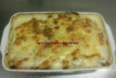 أسهل طريقة عمل صينية بطاطس جريتان بصوص الباشميل والجبن  Backed Potato with béchamel sauce and cheese
