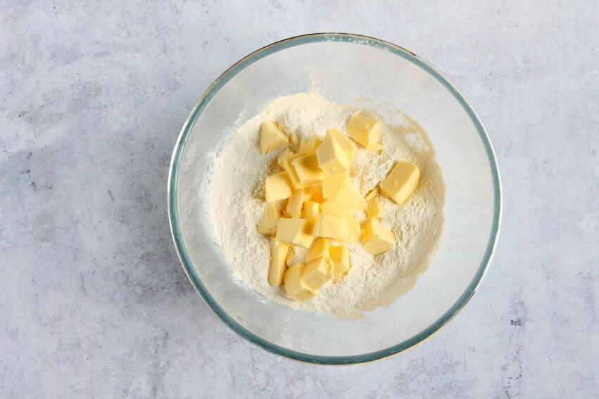 Flour and butter in mixing bowl
