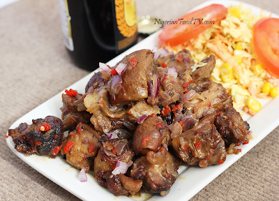 Asun Recipe ( spicy smoked peppered goat meat) asun | Nigerian Small Chop