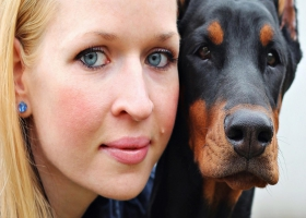 A picture of a women and dog face.