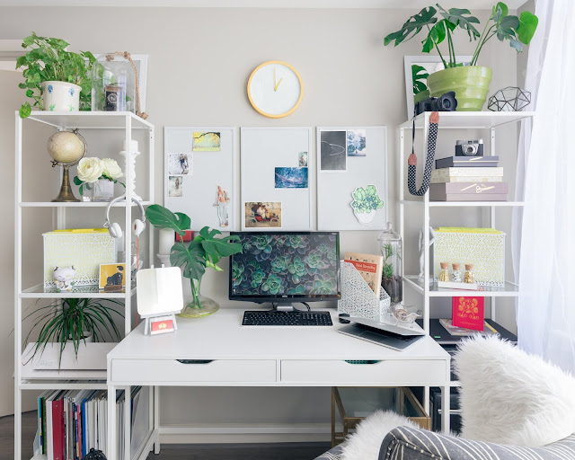 desk with computer and plants