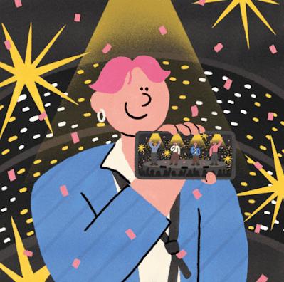 Grafika z postacią młodego chłopaka z różowymi włosami, kolczykiem w uchu, trzymającego telefon. Na telefonie wyświetlany jest występ. W tle reflektory.