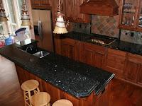 How To Choose A Good Emerald Pearl Granite Countertops